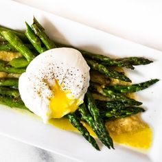Pan Roasted Asparagus atop a bed of Roasted Garlic Miso Butter, topped with a poached egg - creating a creamy sauce. Delicious!