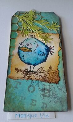Tag met de bird grazy stamps en distressink van Tim Holtz.... Monique