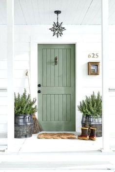 Rosemary (Sherwin-Williams paint color) on a front door. #rosemary #sherwinwilliamsrosemary #paintcolors #greenpaints