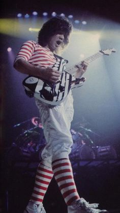 Eddie Van Halen in 1981 with his circle guitar with some stripes on it now Eddie has that guitar for everyone to buy but sure is expensive. What a beautiful guitar