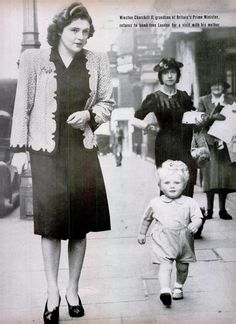 20 month old Winston Churchill, grandson of the Prime Minister was sent to the countryside during the war, he is pictured on a visit with his mother during a lull in the bombing. June 5, 1942. London. [685 x 942]