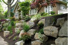 rock garden retaining wall, via precision landscape.