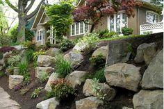 rock garden retaining wall, via precision landscape.