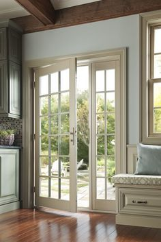 French doors with grids for a traditional look in this summer house. Open the doors and enjoy the breeze.  Featured: Tuscany Series doors. Click to request a brochure.