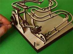 The Automata Blog: Laser-cut marble machine kit with a catapult lifting arm