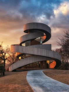 Ribbon Chapel by Hiroshi Nakamura & NAP Co. Ltd - The Ribbon Chapel comprises of 2 spiral staircases that begin at separate points and slowly wind upward to join in an observation platform at the top of the building. It is located in the picturesque grounds of a hotel overlooking the Inland Sea of Japan. The joining of the staircases is symbolic of marriage #architecture...x