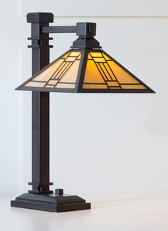 Noir Mission Lamp--Individually cut and hand-soldered pieces of glass form a shade of undeniable beauty that celebrates the spare geometric forms of the Mission Style artistic movement of the past century. Cast-zinc base with antiqued finish completes the picture.