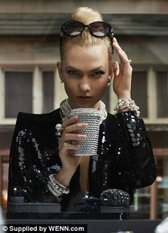 Going back in time: And Karlie didn't stop there as she channelled the beautiful Audrey Hepburn from the legendary 1961 film Breakfast At Tiffany's, where she sat at the table