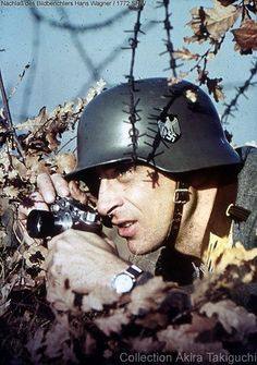 A German war reporter for the Reich's press huddles down in the brush to avoid gunfire as he documents the invasion of Poland alongside the Wehrmacht. Fall, 1939.