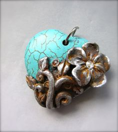 I just love playing with polymer clay and swellegant dyes/patinas! by…