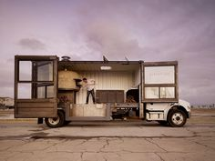 Re-purposed shipping container transformed to mobile pizzeria brick oven and all.