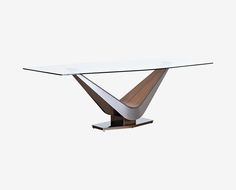Dania - The Dermae dining table will be the talk of your next dinner party with its elegant arching design crafted from brushed stainless steel and a walnut inlay. Crowned with an elegant glass top, the Dermae dining table is a true work of art.
