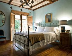 Walls of the master bedroom are limewashed in Larder Blue by Portola Paints & Glazes; the plaster of the ceiling was left natural.