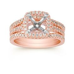 Rose gold halo engagement and wedding set from Shane Co. I tried this one on a while ago and loved it. It doesn't have the pretty profile of some of the others though. I do love the double wedding bands that encase the engagement ring. This can be set with a big pretty white sapphire from Shane Co.