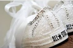 Cool wedding day converse DIY! -first buy white converse then get some fabric glue , glitter, rhinestones, and tool. Next put fabric glue all over the shoe then you put glitter all over (put on a few coats). So once you do that you collect your rhinestones,  put fabric glue on each rhinestone and apply each rhinestone on the outlining of the shoe. Finally get your tool and the shoestrings you'll then wrap and glue the tool around the shoestring cut off any access and then you're done!!