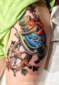 NickTheTailorTattoo did this awesome ships wheel and lantern