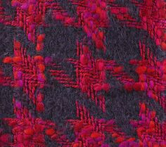 SHIRAZ MOHAIR TWEED SAMPLE, 1964. Double cloth houndstooth fabric, woven in brushed mohair and multiply wool slub yarns, and wool and polyester yarns, in dark blue, purple, orange, pink and red.