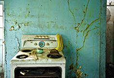 and then, there's that stove....   Flickr - Photo Sharing! i love the stove!  Again did the owner die and the family just walked away from the home?