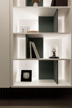 shelves at entry edge of wall of storage, black and white with turquoise objects