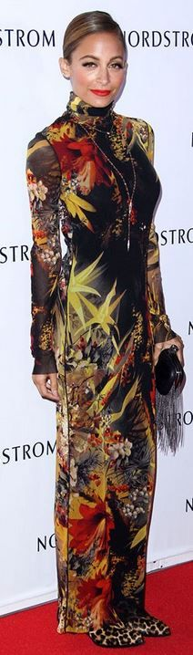 Who made  Nicole Richie's black fringe handbag and print long sleeve gown?