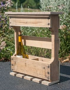 This handmade rustic wine rack created from reclaimed pallet boards would make a perfect mother's day gift! #byDadandDaughter #Mother'sDay #Gift #Wine #Mom