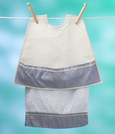 Size large (2-5 years of age) This fine, lustrous, silky blue lavender taffeta and cream sleeveless Bibock with Lapkin will illuminate your precious one at the holiday table. This would also be a lovely addition to a birthday party or special occasion. This oh so glamourous Bibock is a bit la- di-da and why not! Don't we all need a little bit of sparkle added to our everyday world view? Just like people, taffeta has it's own personality. It has a wrinkling quality, similar to linen, that is…