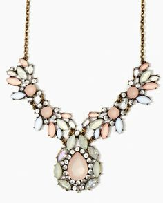 Shop bib necklaces.Trendy pink, pearl, rhinestones and mixed metals with a standout pendant and chunky gem accent. Faceted jewels and vintage metal base make a style statement.