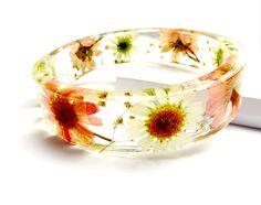 Resin Bangle Bracelet. Real Flowers, Romantic Pink Daisy Resin Bangle Bracelet: Abigail. $38.00, via Etsy.