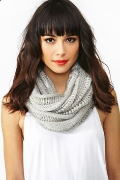 Dark hair with straight bangs, wearing Infinity Scarf