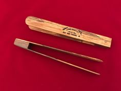 Handy little gadget to remove toast, bagels, English muffins, et cetera, from the toaster while saving your fingers. Great as a hostess gift, stocking stuffer, wishing well gift, et cetera. Handmade of wood from a sweet gum tree. The oil-based finish brings out the grain of the