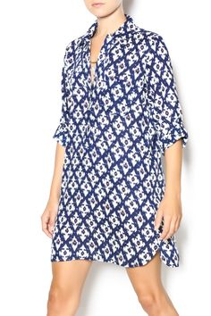A striking print shirtdress in a lightweight woven fabric decorated in a blue, white and touch of coral Ikat motif. Collared neckline with chest pocket leads into a quarter length button placket, while 3/4 roll tab sleeves finish this chic look. Slim fit. Shift silhouette finishes in a cute and subtly rounded hem. Team with ankle boots for effortless style   Ikat Can You Dress by Twist. Clothing - Dresses - Printed Clothing - Dresses - Casual Santa Monica, Los Angeles, California
