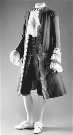 Eighteenth-century suit. During the reign of King Charles II, the three-piece suit, which consisted of knee breeches, a vest, and a jacket, became the standard dress for men.