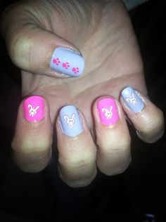 Peter Cottontail hopping down the bunny trail.  Pink & purple nail polish with bunny & paw print stickers.