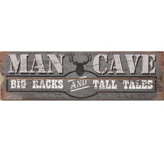 """Rustic MDF (Medium Density Fiberboard) wall plaque with weathered wood plan design. Deer head graphic and MAN CAVE BIG RACKS AND TALES sentiment. MDF and paper. measures 31.5"""" X 0.8"""" X 9.5"""""""