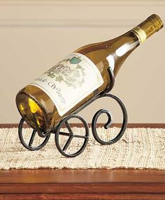 This Iron Wine Bottle Holder is great for entertaining or everyday use. The unique holder is an attractive decoration for any wine lover's buffet or dining table.