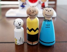 The Peanuts Gang Charlie Brown, Lucy, Snoopy and Woodstuck hand painted wooden peg dolls toy peg people by Pegatopia on Etsy https://www.etsy.com/listing/236142407/the-peanuts-gang-charlie-brown-lucy