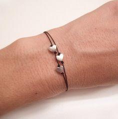 Simple Bracelet - Silver Heart Tiny Trio. $26.50, via Etsy.