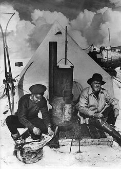 Expedition photographer Frank Hurley, left, and Sir Ernest Shackleton, right, in front of their small tent at camp on the Weddell Sea