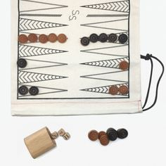Roll-Up Backgammon/Checker Set ($65) - No Wi-Fi, no problem. Entertain yourselves the old-fashioned way with these totable games. The cloth bag doubles as checkers and backgammon boards on either side and can hold extras, like, ahem, another flask to keep the matches interesting.