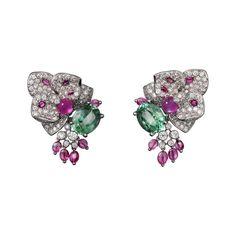 "CARTIER. ""Disa"" Earrings - white gold, star rubies, tourmalines, brilliant-cut diamonds. #Cartier #CartierMagicien #HauteJoaillerie #HighJewellery #FineJewelry #StarRuby #Tourmaline #Diamond"