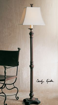 """Uttermost """"Nathan"""" 66"""" floor lamp by Carolyn Kinder.  Distressed mahogany wood tone with burnished black edges and cast aluminum accents; square bell shade French ivory linen."""