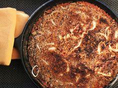Easy Skillet Cassoulet (olive oil, pork sausages, pork tenderloin, salt, black pepper, onion, garlic, tomatoes, beans, chicken stock, shallot, breadcrumbs, dried thyme, dried oregano, extra-virgin olive oil)