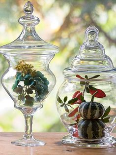 Apothecary jars filled with fall finds make for elegant decoration. More Thanksgiving ideas: http://www.bhg.com/thanksgiving/indoor-decorating/thanksgiving-decorating-with-nature/?socsrc=bhgpin110512apothecaryarangement#page=3