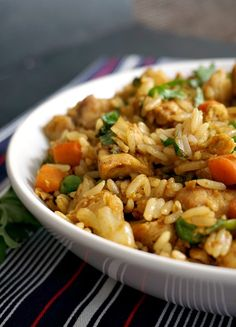 A white bowl of Healthy Chinese chicken egg fried rice