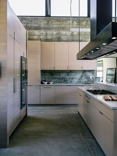 A simple yet elegant kitchen provides plenty of space to prepare a meal.