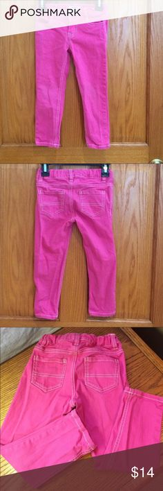 OshKosh Pink Skinny Jeans Adorable pink with white stitching skinny jeans.  Snap and zip closure. 📌there is a light mark on front part of pants, hardly noticeable. Good condition. Adjustable band inside pants. 98% cotton and 2% spandex. Osh Kosh Bottoms Jeans