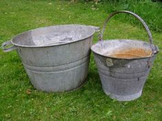 buckets..a girl can't have too much galvanized metal around...I love to plant things in galvanized buckets and tubs and I love old watering cans.