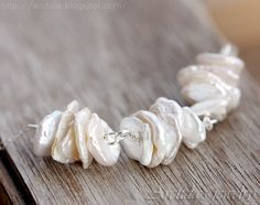 Leia - Bridal white Keshi pearls necklace in sterling silver. Handmade wedding jewelry by Arctida $45 #handmade #wedding #bridal #bride #jewelry #jewellery #necklace #keshi #keishi #white #ivory #pearl