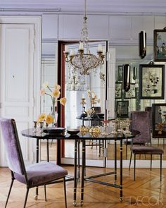 Mirrored wall and chic violet velvet is pure glamour
