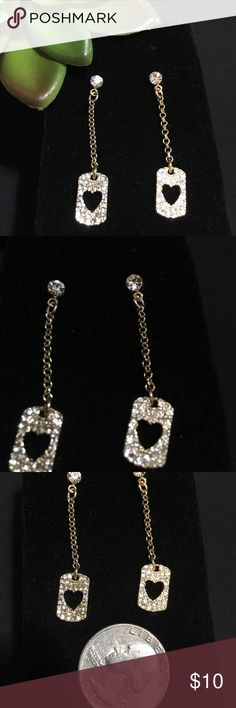 Juicy Couture Dangle earrings Juicy Couture Dangle earrings. Rhinestones on gold. Dangle earrings with heart cutouts surrounded by rhinestones. Approx 1 3/4 drop Juicy Couture Jewelry Earrings